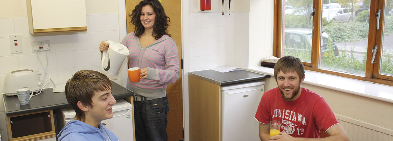 Students in the communal kitchen