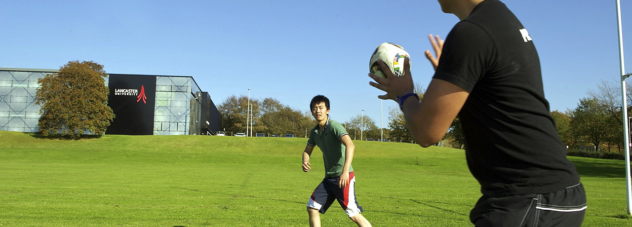 Students play on the rugby pitch