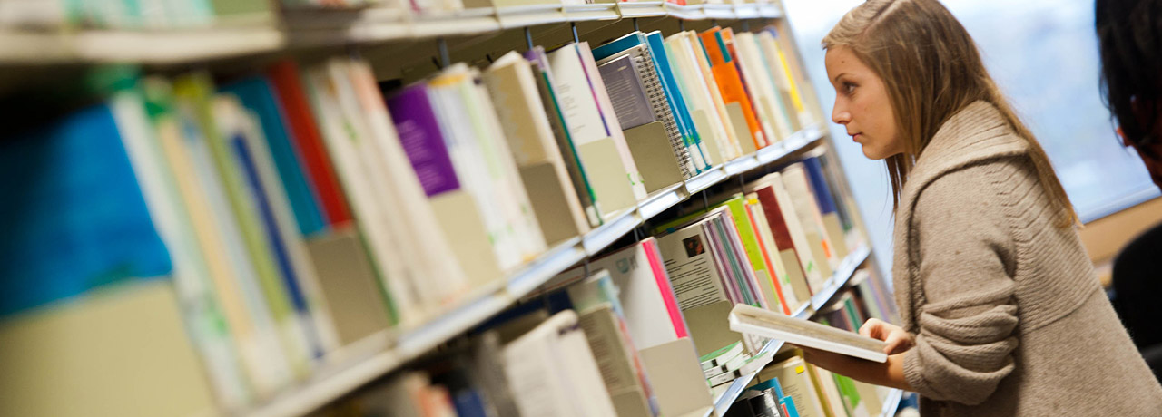 Student browsing the library books